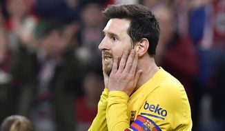 FILE - In this Feb. 6, 2020 file photo, Barcelona's Lionel Messi reacts during the Spanish Copa del Rey, quarter final, soccer match against Athletic Bilbao at the San Mames stadium in Bilbao, Spain. Lionel Messi has told Barcelona he wants to leave the club after nearly two decades with the Spanish giants. The club has confirmed that the Argentina great has sent a note expressing his desire to leave. The announcement comes 11 days after Barcelona's humiliating 8-2 loss to Bayern Munich in the Champions League quarterfinals, one of the worst in the player's career and in the club's history. (AP Photo/Alvaro Barrientos, File)
