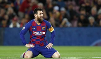 In this Nov. 5, 2019 file photo, Barcelona's Lionel Messi reacts during a Champions League Group F soccer match against Slavia Praha at Camp Nou stadium in Barcelona, Spain. Lionel Messi has told Barcelona he wants to leave the club after nearly two decades with the Spanish giants. The club has confirmed that the Argentina great has sent a note expressing his desire to leave. The announcement comes 11 days after Barcelona's humiliating 8-2 loss to Bayern Munich in the Champions League quarterfinals, one of the worst in the player's career and in the club's history. (AP Photo/Joan Monfort, File)  **FILE**