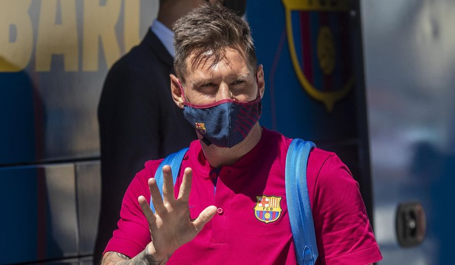 In this Aug. 13, 2020 file photo, Barcelona's Lionel Messi waves as he arrives at the team hotel in Lisbon, Portugal. Lionel Messi has told Barcelona he wants to leave the club after nearly two decades with the Spanish giants. The club has confirmed that the Argentina great has sent a note expressing his desire to leave. The announcement comes 11 days after Barcelona's humiliating 8-2 loss to Bayern Munich in the Champions League quarterfinals, one of the worst in the player's career and in the club's history.(AP Photo/Manu Fernandez, File)  **FILE**