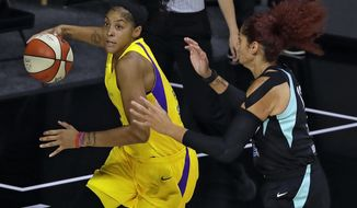 FILE - In this Tuesday, Aug. 11, 2020, file photo, Los Angeles Sparks forward Candace Parker, left, drives to the basket past New York Liberty center Amanda Zahui B. (17) during the first half of a WNBA basketball game  in Bradenton, Fla. Parker was a freshman at Tennessee the first time she ever voted in a U.S. election. It left a lasting impression on her and now 16 years later she's hoping to get others to understand the importance of voting too. (AP Photo/Chris O'Meara, File)