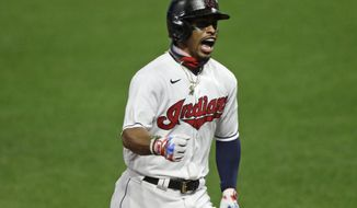 Cleveland Indians' Francisco Lindor reacts as he runs the bases after hitting a two-run home run in the sixth inning in a baseball game against the Minnesota Twins, Tuesday, Aug. 25, 2020, in Cleveland. (AP Photo/Tony Dejak)