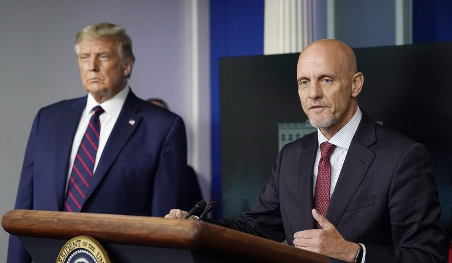 President Donald Trump listens as Dr. Stephen Hahn, commissioner of the U.S. Food and Drug Administration, speaks during a media briefing in the James Brady Briefing Room of the White House, Sunday, Aug. 23, 2020, in Washington.(AP Photo/Alex Brandon)