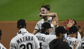 Chicago White Sox starting pitcher Lucas Giolito, center, reacts with teammates after closing out a no hitter at the end of a baseball game against the Pittsburgh Pirates, Tuesday, Aug. 25, 2020, in Chicago. (AP Photo/Matt Marton)  **FILE**