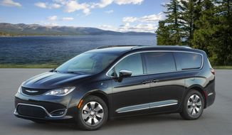 This photo provided by FCA shows the Chrysler Pacifica Hybrid, a plug-in hybrid minivan that has both a gasoline engine and hybrid system. It can drive for around 30 miles on electricity alone. (Courtesy of Fiat Chrysler via AP)