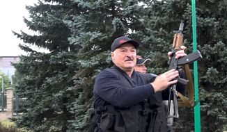"""FILE - This Aug. 23, 2020, file image made from video provided by the State TV and Radio Company of Belarus, shows Belarus President Alexander Lukashenko armed with a rifle near the Palace of Independence in Minsk, Belarus. His office released a video showing Lukashenko landing in a helicopter nearby and brandishing a Kalashnikov rifle as protesters marched nearby. He called the protesters """"rats"""" as he inspected riot police guarding the residence. His youngest son, 15-year-old Nikolai, walked nearby, also carrying a rifle. (State TV and Radio Company of Belarus via AP, File)"""