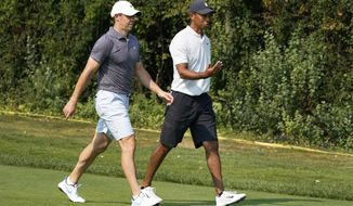 Rory McIlroy, left, and Tiger Woods head down the first hole during a practice round Wednesday, Aug. 26, 2020, for the BMW Championship golf tournament at the Olympia Fields Country Club in Olympia Fields, Ill. (AP Photo/Charles Rex Arbogast)