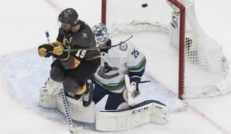 Vegas Golden Knights' Reilly Smith (19) jumps as the puck goes past Vancouver Canucks goalie Jacob Markstrom (25) during the third period of Game 2 of an NHL hockey second-round playoff series, Tuesday, Aug. 25, 2020, in Edmonton, Alberta. (Jason Franson/The Canadian Press via AP)