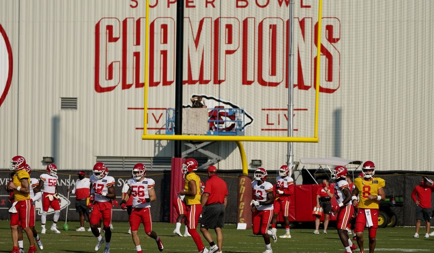 Kansas City Chiefs players work out during an NFL football training camp practice Monday, Aug. 24, 2020, in Kansas City, Mo. (AP Photo/Charlie Riedel)