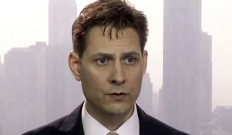 FILE - In this March 28, 2018, file image made from video, Michael Kovrig, an adviser with the International Crisis Group, a Brussels-based non-governmental organization, speaks during an interview in Hong Kong. China said Wednesday, Aug. 26, 2020, it remains firm in its insistence that Canada make the first move to end the detention of two Canadians, following a meeting of the two countries' foreign ministers.  (AP Photo, File)