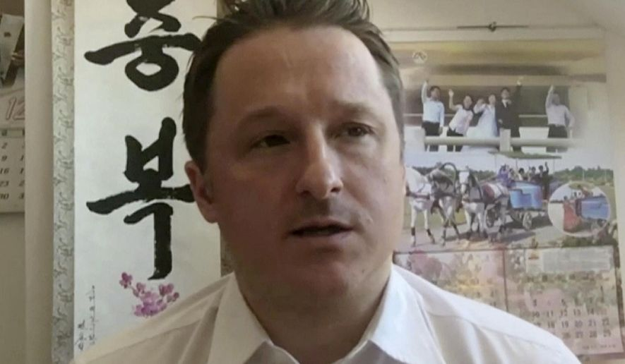 FILE - In this March 2, 2017, file image made from video, Michael Spavor, director of Paektu Cultural Exchange, talks during a Skype interview in Yanji, China. China said Wednesday, Aug. 26, 2020, it remains firm in its insistence that Canada make the first move to end the detention of two Canadians, following a meeting of the two countries' foreign ministers.  (AP Photo, File)