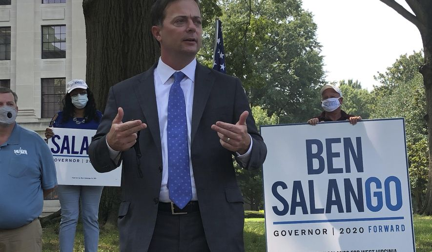 West Virginia Democratic gubernatorial candidate Ben Salango, speaks during a stop Wednesday, Aug. 26, 2020, outside the state Capitol in Charleston, W.Va. Salango has embarked on a statewide tour that will take him to 11 cities in three days. He faces Republican incumbent Gov. Jim Justice in November. (AP Photo/John Raby)