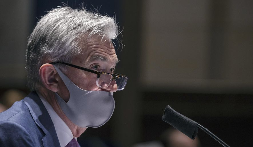 In this June 30, 2020, file photo, Federal Reserve Chair Jerome Powell testifies during a House Financial Services Committee hearing on the coronavirus response on Capitol Hill in Washington. (Tasos Katopodis/Pool via AP) ** FILE **