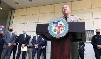 """Los Angeles County Sheriff Alex Villanueva talks  during a news conference, Wednesday, Aug. 26, 2020, outside the Los Angeles Police Department Headquarters, with members of the """"Safe LA Task Force"""", announcing arrests for arson, looting, assault and vandalism, among other crimes, that occurred during protests against police brutality in the Los Angeles region. (AP Photo/Stefanie Dazio)"""