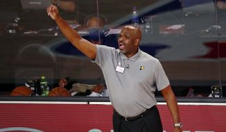 Indiana Pacers head coach Nate McMillan reacts on the sideline during the second half of Game 3 of an NBA basketball first-round playoff series against the Miami Heat, Saturday, Aug. 22, 2020, in Lake Buena Vista, Fla. (Kim Klement/Pool Photo via AP)  **FILE**