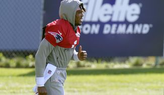 New England Patriots quarterback Cam Newton walks to the field for an NFL football training camp practice, Wednesday, Aug. 26, 2020, in Foxborough, Mass. (AP Photo/Steven Senne, Pool)