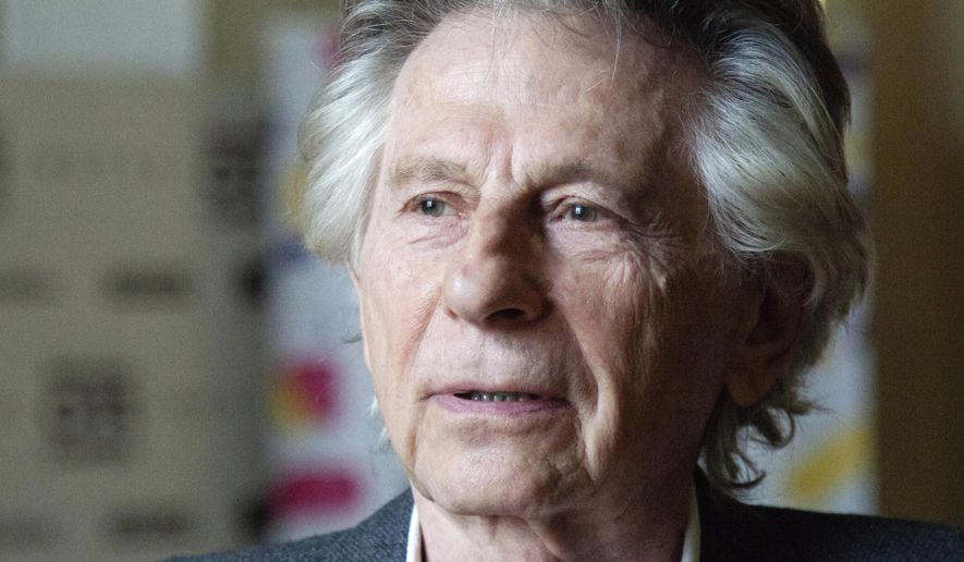 """FILE - In this May 2, 2018, file photo, director Roman Polanski appears at an international film festival, where he promoted his latest film, """"Based on a True Story,"""" in Krakow, Poland. A judge on Tuesday, Aug. 25, 2020, denied Polanski's request to restore his membership into the Academy of Motion Picture Arts and Sciences, the organization that bestows the Academy Awards two years after he was expelled from it for raping a minor. The fugitive film director sued in April 2019, asking the court to compel the organization to make him a member in good standing again.  (AP Photo/File)"""