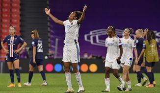 Lyon's Wendie Renard celebrates at the end of the Women's Champions League semifinal soccer match between Lyon and Paris Saint-Germain in Bilbao, Spain, Wednesday, Aug. 26, 2020. Lyon won the match 1-0. (AP Photo/Alvaro Barrientos,Pool)
