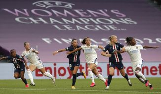Lyon and PSG players wait for a cross to arrive during the Women's Champions League semifinal soccer match between Lyon and Paris Saint-Germain in Bilbao, Spain, Wednesday, Aug. 26, 2020.(Villar Lopez/Pool via AP)