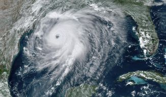 """This GOES-16 GeoColor satellite image taken Wednesday, Aug. 26, 2020, at 2:40 p.m. EDT., and provided by NOAA, shows Hurricane Laura over the Gulf of Mexico. Hurricane Laura strengthened Wednesday into """"an extremely dangerous Category 4 hurricane,"""" The National Hurricane Center said.Laura is expected to strike Wednesday night into Thursday morning along the Louisiana-Texas border. (NOAA via AP)"""