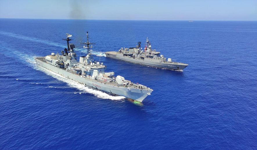 Italian destroyer ITS Durand De La Penne, left, along with Turkish frigates TCG Goksu and TCG Fatih conduct maritime trainings in the Eastern Mediterranean Tuesday, Aug. 25, 2020,  to improve coordination and interoperability.(Turkish Defense Ministry via AP, Pool)