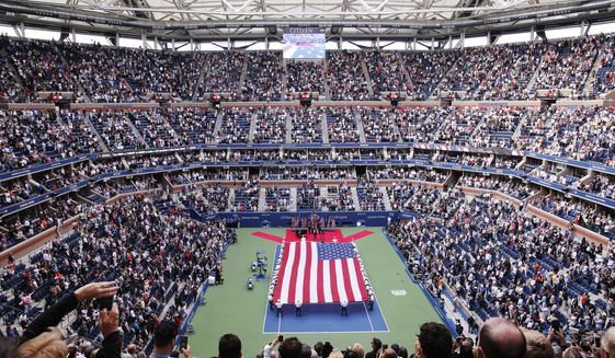 FILER - In this Sept. 10, 2017, file photo, cadets from the West Point military academy present the American flag across the court at Arthur Ashe Stadium before the start of the men's singles final of the U.S. Open tennis tournament, between Rafael Nadal and Kevin Anderson, in New York. The 2020 U.S. Open tennis tournament is scheduled for Monday, Aug. 31-Sunday, Sept. 13. (AP Photo/Seth Wenig, File)