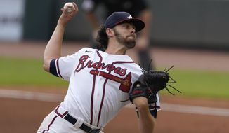 Atlanta Braves starting pitcher Ian Anderson works against the New York Yankees in the fourth inning of game one of baseball doubleheader Wednesday, Aug. 26, 2020, in Atlanta. (AP Photo/John Bazemore)