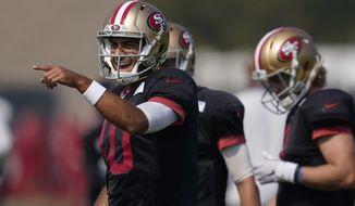 San Francisco 49ers quarterback Jimmy Garoppolo (10) gestures during NFL football practice in Santa Clara, Calif., Saturday, Aug. 22, 2020. (AP Photo/Jeff Chiu, Pool)