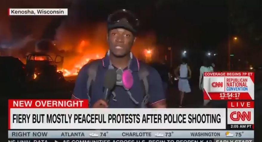 """CNN correspondent Omar Jimenez discusses fallout in Kenosha, Wisconsin, after the police shooting of Jacob Blake Jr. The network's """"fiery but most peaceful"""" chyron stunned social media viewers, Aug. 26, 2020. (Image: CNN video screenshot)"""