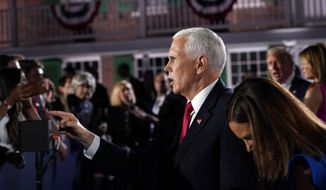 Vice President Mike Pence and his wife Karen Pence greet supporters on the third day of the Republican National Convention at Fort McHenry National Monument and Historic Shrine in Baltimore, Wednesday, Aug. 26, 2020. (AP Photo/Andrew Harnik)