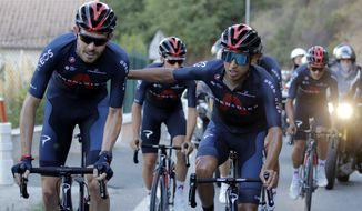Colombia's Egan Bernal, center, rides with teammate Britain's Luke Rowe, left, during a training session outside Nice, southern France, ahead of upcoming Saturday's start of the race, Thursday, Aug. 27, 2020. The Tour de France sets off shrouded in uncertainty and riding in the face of the coronavirus pandemic and mounting infections in France. (AP Photo/Christophe End)