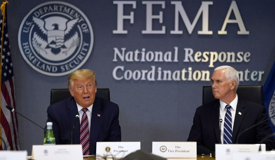 President Donald Trump speaks during a Hurricane Laura briefing at FEMA headquarters, Thursday, Aug. 27, 2020, in Washington. Vice President Mike Pence is at right. (AP Photo/Evan Vucci)