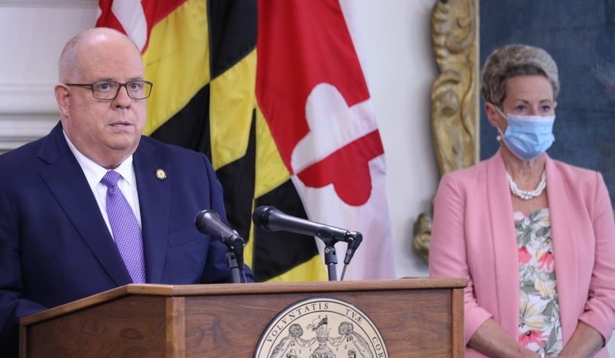 Maryland Gov. Larry Hogan announces that all of the state's school systems meet safety standards to reopen for some in-person instruction during a news conference, Thursday, Aug. 27, 2020 in Annapolis, Md., as some of the state's counties are opting for online-only instruction at the start of the school year due to the coronavirus pandemic. Karen Salmon, the state's superintendent of schools, is standing right. (AP Photo/Brian Witte)  **FILE**