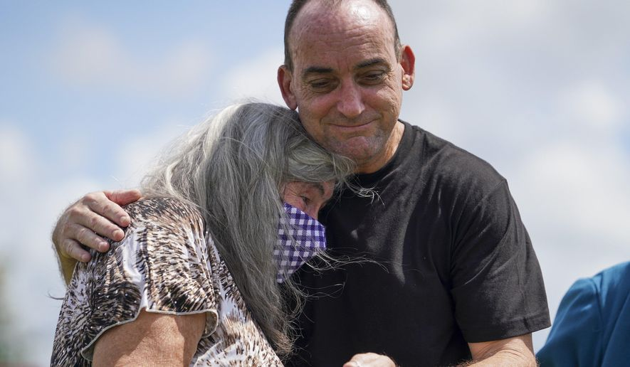 Robert Duboise hugs his mother after being released from prison Thursday, Aug. 27, 2020, in Bowling Green, Fla. Duboise, who spent the last 37 years in prison on a rape and murder charge, was ordered released after officials discovered new evidence that proved his innocence. (Martha Asencio-Rhine/Tampa Bay Times via AP)
