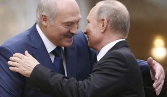 FILE- In this file photo taken on Thursday, Nov. 30, 2017, Belarusian President Alexander Lukashenko, left, greets Russian President Vladimir Putin during the Collective Security Council of the Collective Security Treaty Organization (CSTO) summit in Minsk, Belarus. Putin warned that he stands ready to send police to Belarus if protests there turn violent, but added in an interview broadcast Thursday that there is no such need now and voiced hope for stabilizing the situation in the neighboring country. (Tatyana Zenkovich, Pool Photo via AP, File)