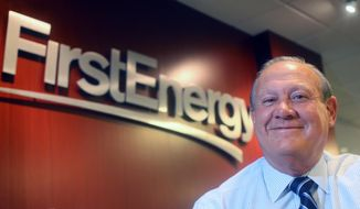"FILE - In this 2015 file photo, FirstEnergy Corp. President and CEO Charles ""Chuck"" Jones appears at the company's Akron, Ohio headquarters. Akron-based FirstEnergy Corp. has long maintained it had no financial stake in getting out of the business of operating nuclear power plants. But federal authorities say FirstEnergy bankrolled a $60 million bribery scheme aimed at getting the bailout approved in the Ohio Legislature. (Phil Masturzo//Akron Beacon Journal via AP, File)"