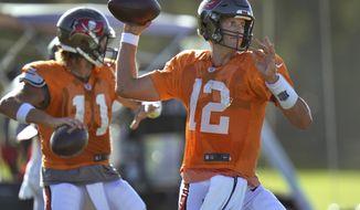 Tampa Bay Buccaneers quarterback Tom Brady (12) and quarterback Blaine Gabbert (11) throw passes during an NFL football training camp practice Monday, Aug. 24, 2020, in Tampa, Fla. (AP Photo/Chris O'Meara)