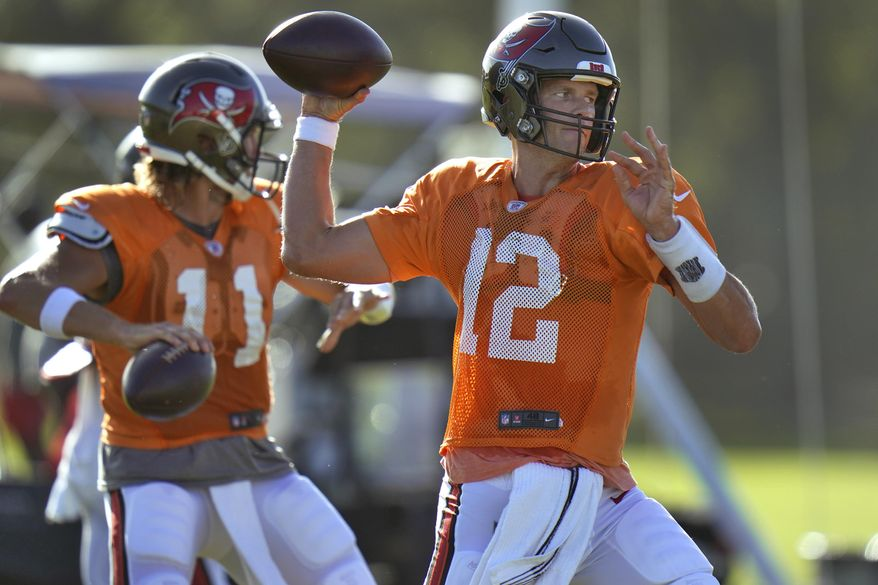Tampa Bay Buccaneers quarterback Tom Brady (12) and quarterback Blaine Gabbert (11) throw passes during an NFL football training camp practice Monday, Aug. 24, 2020, in Tampa, Fla. (AP Photo/Chris O'Meara)