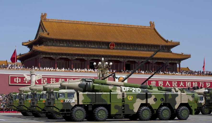 """In this Sept. 3, 2015, file photo, Chinese military vehicles carrying DF-21D anti-ship ballistic missiles, potentially capable of sinking a U.S. Nimitz-class aircraft carrier in a single strike, pass by Tiananmen Gate during a military parade to commemorate the 70th anniversary of the end of World War II, in Beijing. China's military test-fired two missiles into the South China Sea, including a """"carrier killer"""" military analysts suggest might have been developed to attack U.S. forces, a newspaper reported Thursday, Aug. 27, 2020. (AP Photo/Andy Wong, Pool, File)  **FILE**"""