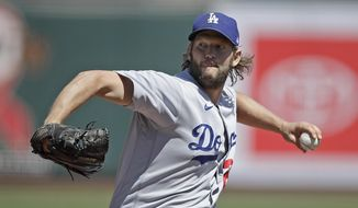 Los Angeles Dodgers' pitcher Clayton Kershaw works against the San Francisco Giants in the first inning of the first game of a baseball doubleheader Thursday, Aug. 27, 2020, in San Francisco. (AP Photo/Ben Margot)