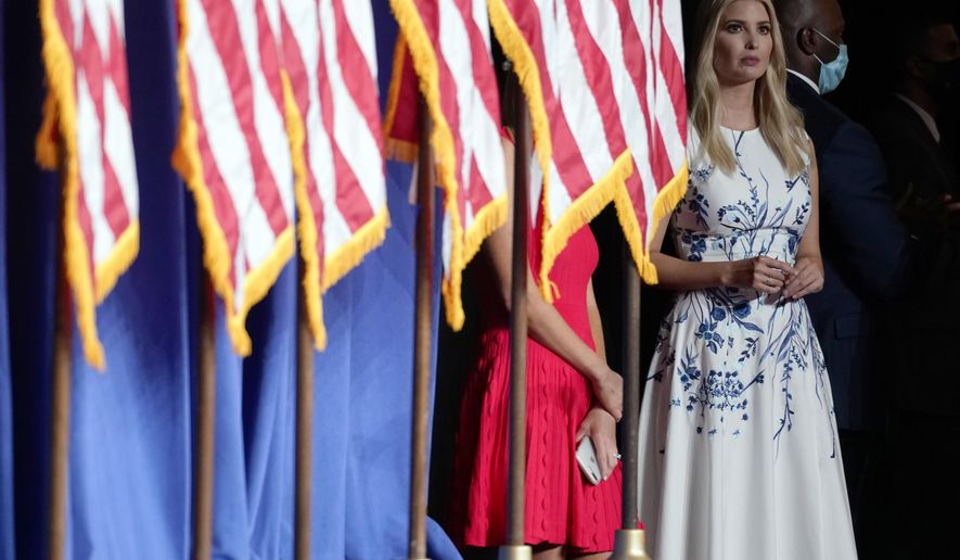 FILE - In this Aug. 24, 2020, file photo Ivanka Trump listens as President Donald Trump speaks at the 2020 Republican National Convention in Charlotte, N.C. On the final night of the Republican National Convention, President Donald Trump will be introduced by his daughter Ivanka Trump , the fourth of his five children to speak during the convention. (AP Photo/Andrew Harnik, File)