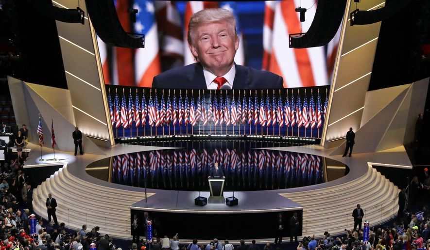 """FILE - In this July 21, 2016, file photo, Republican presidential candidate Donald Trump smiles as he addresses delegates during the final day session of the Republican National Convention in Cleveland. Four years ago, Donald Trump accepted the Republican Party's nomination for president with a dark convention speech that painted a dystopic portrait of an America in decline. And he offered a singular solution. His message was """"I alone can fix it."""" (AP Photo/Patrick Semansky, File)"""