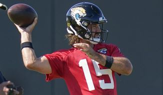 Jacksonville Jaguars quarterback Gardner Minshew II (15) throws a pass during an NFL football workout, Thursday, Aug. 13, 2020, in Jacksonville, Fla. (AP Photo/John Raoux)