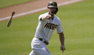 San Diego Padres' Wil Myers reacts after hitting a three-run walkoff home run to defeat the Seattle Mariners in a baseball game Thursday, Aug. 27, 2020, in San Diego. (AP Photo/Gregory Bull)
