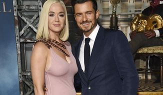 """FILE - This Aug. 21, 2019 file photo shows Orlando Bloom, right, a cast member in the Amazon Prime Video series """"Carnival Row,"""" with singer Katy Perry, at the premiere of the series in Los Angeles.  Perry has given birth to a baby girl named Daisy Dove Bloom. The pop superstar and her partner, actor Orlando Bloom, got UNICEF to announce the news on its Instagram account. Both Perry and Bloom are goodwill ambassadors for the United Nations agency that helps children. (Photo by Chris Pizzello/Invision/AP, File)"""