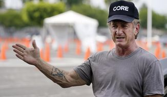 Actor Sean Penn, founder of Community Organized Relief Effort (CORE), is interviewed at a CORE coronavirus testing site at Crenshaw Christian Center, Friday, Aug. 21, 2020, in Los Angeles. Penn says his organization CORE has made some strides against the coronavirus and he's keeping its mission going by expanding testing and other relief services. (AP Photo/Chris Pizzello)