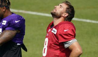 Minnesota Vikings quarterback Kirk Cousins (8) does neck stretch the NFL football team's training camp Monday Aug. 24, 2020, in Eagan, Minn. (AP Photo/Jim Mone)