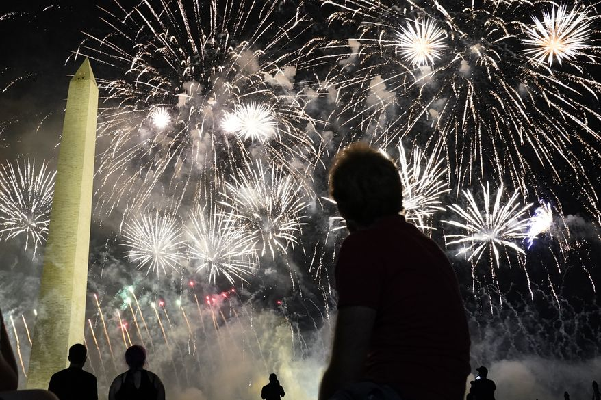 People watch fireworks near the Washington Monument on the fourth day of the Republican National Convention, Thursday, Aug. 27, 2020, in Washington. (AP Photo/Andrew Harnik)