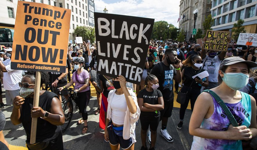 """Marchers chant as they gather at Black Lives Matter Plaza near the White House in Washington, during the March on Washington, Friday, Aug. 28, 2020, commemorating the 57th anniversary of the Rev. Martin Luther King Jr.'s """"I Have A Dream"""" speech. (AP Photo/Manuel Balce Ceneta)"""