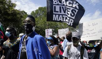 People march from the Lincoln Memorial to the Martin Luther King Jr. Memorial during the March on Washington, Friday Aug. 28, 2020, in Washington. (AP Photo/Jacquelyn Martin)