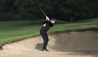England's Eddie Pepperell hits from a bunker on the 3rd hole during day two of the UK Championship golf tournament at The Belfry, Sutton Coldfield, England, Friday Aug. 28, 2020. (David Davies/PA via AP)